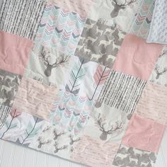 This item is made to order- please allow 2 weeks for production. • The quilt top features a patchwork of different pink, mint, and gray woodland fabrics, some fabrics have gold metallic. The quilt top is 5 squares across, 6 squares down; the fabric is 100% cotton. • This quilt has a