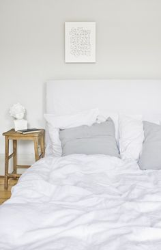 white bed. little table.