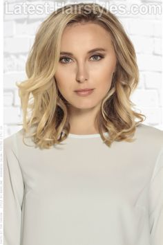 Blonde Haircolor with Light Brown Base. DIMENSIONAL BLONDE  Look like you had a fabulous summer spent at the beach by giving your hair a soft, sunkissed look while still maintaining a light brown base.