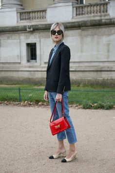 PARIS, FRANCE - OCTOBER 6: Fashion Blogger Linda Tol wears Chanel shoes, Saint Laurent jacket, Calvin Klein shirt, Acne jeans, Fendi sunglasses and a Loewe bag on day 8 during Paris Fashion Week Spring/Summer 2016/17 on October 6, 2015 in London, England. (Photo by Kirstin Sinclair/Getty Images)*** Local Caption *** Linda Tol