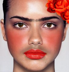 Bright representation of a inspired Frida makeup.