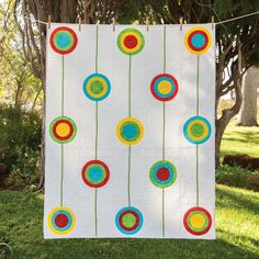 """The design of colorful retro circles embellished with decorative yarn brings a bit of whimsy to the GO! Retro Circles Quilt. This pattern is included on the packaging of the die GO! Big Circle-4"""", 6"""", 7"""", 8"""" (55462).Compatible with these fabric cutters:GO! Big"""