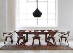 We♥ the 'Beat' light by Tom Dixon, a walnut dining table by Matthew Hilton or a set of 'Cherner' chairs by Norman Cherner (all pictured). Simply shop online, visit http://www.conranshop.co.uk/elle-decoration/