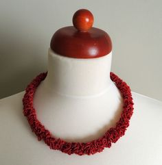 Level - 21 - no pattern, can we figure this out?  - zsazsazsu: crochet jewelry (is this level 24 I-cord type work with irregular yarn? or is it a tight corkscrew..., what is this?)