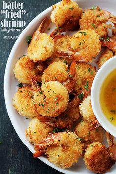 "Baked Batter ""Fried"" Shrimp with Garlic Dipping Sauce - If you are a fan of Red Lobster's Batter Fried Shrimp, then you are going to LOVE this healthier, homemade version in which the shrimp are baked instead of fried and they taste amazing!"