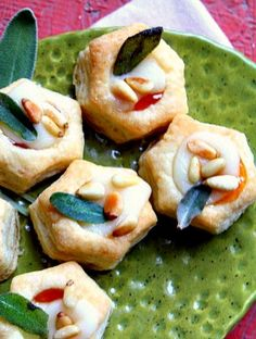Apricot Brie Bites with Fried Sage are delicious easy appetizers garnished with pine nuts. Its colors fit the fall season impeccably well, so bake a batch of this recipe for a holiday party!