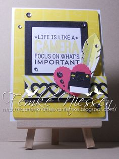 "made by femke niessen: life is like a camera... I used a sketch from cardabilities. MFT stamps ""picture this, textile"". MFT dienamics: blueprints 6, instaframe, hearts a plenty, feathers and arrows, layered heart border, fishtail flags, cute cameras""."