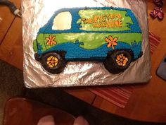 Mystery Machine Birthday Cake  - Made something similar for 4th birthday - notice the wheels are actually mini chocolate donuts.