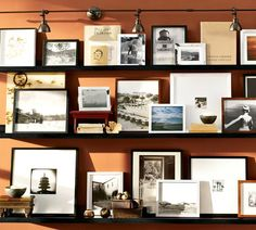 idea for the big blank space in the living room – gallery wall/shelves. so i can change it up when i get bored with it and not have to commit to hanging pictures on the wall. :)
