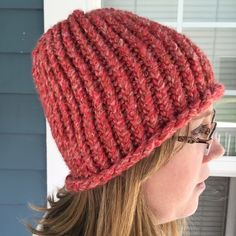 Chunky Knit Red Snow Hat Chunky Knit Red Snow Hat.  Reversible.  Wear with Pom-Pom on top or not.  Red/pink variegated chunky yarn. Accessories Hats