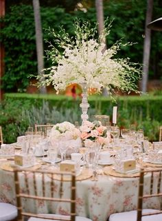 tablescapes, when using height for center pieces allow your guests to see each other.  DYI hot glue inexpensive glass candle sticks together.