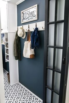 DIY Moroccan Vinyl Tile Floor | blesserhouse.com- A DIY tutorial for how to install moroccan peel & stick vinyl tiles. Less messy than paint. Less time-consuming and less expensive than real tile! #laundry #laundryroom
