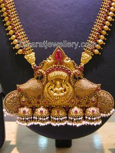 Jewellery Designs: Gold Beaded Laxmi Long Chains
