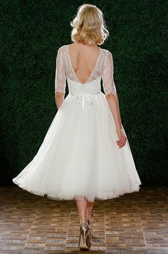 Elegant tea-length wedding dress with lace sleeves. Watters, Spring 2015