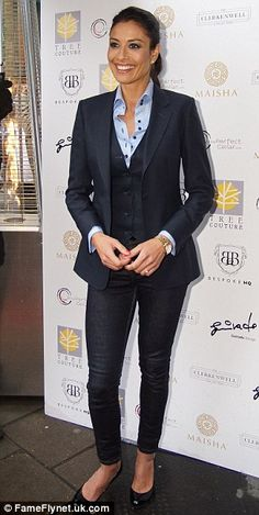 Masculine chic: Melanie Sykes looked great in shirt, waistcoat and blazer