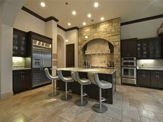 Frosted brown cabinets and modern bar stools at 4600 Charles Ave, Austin TX #kitchens #austinrealestate #homedecor
