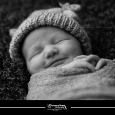 newborn-baby boy smiles www.dimensions-photography.com