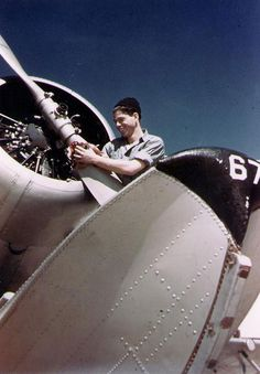 US Navy Aviation Machinist's Mate polishing the propeller of a SOC Seagull floatplane at Naval Air Station, Pensacola, Florida, United States, circa 1940-41