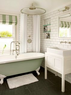 Double Pedestal Sinks With Tall Cabinet In Between For Storage Bathrooms