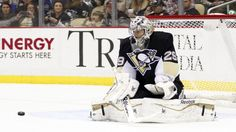 Marc-Andre Fleury lunges out for blocker save.