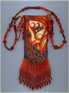 Pyra (or Fire) is the second in the series of the Elements.  Her companion bags are Earth, Water, Wind.  beaded amulet pattern by Chris Manes of A Muse Ink Beadwork Designs