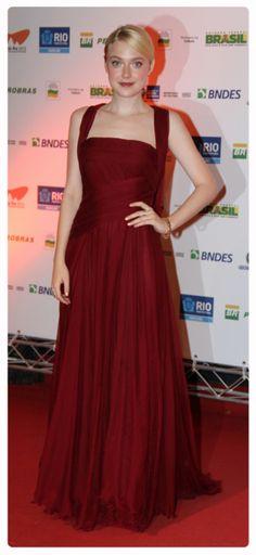 Dakota Fanning red carpet style: dark red gown, sleek hair & glowing makeup