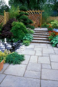 Bluestone paver patio with inlaid chess set, plantings, hot tub, steps, levels, arbor, patio set.....a beautiful place, love it!!