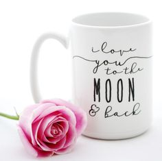 "Fifteen ounce coffee mug with the sweet declaration, ""I Love You to the MOON & Back"". The entire design and production of each mug takes place in our Richmond, Va. studio using professional supplies a Chocolate Covered Coffee Beans, Painted Coffee Mugs, Valentines Mugs, Cute Cups, Do It Yourself Crafts, White Gift Boxes, Ceramic Mugs, Mug Designs, Coffee Cups"