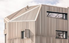 A sculptural relief in anodized aluminum was developed for the roof and facade