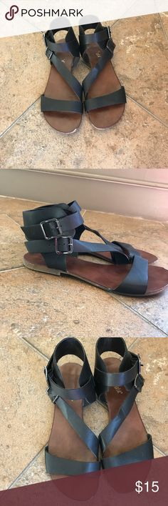 Black and brown gladiator sandals Super cute sandals! Small wear at the toe, but you don't notice it when you wear them Shoes Sandals