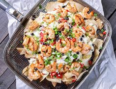 Grilled Shrimp and Pepper Jack Cheese Nachos -- these look amazing!