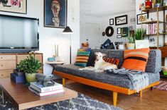 The grey platform sofa is from Urban Outfitters.