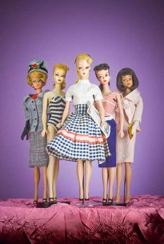 """1960s Barbies with """"Bild Lily"""" in front, the German doll that inspired Barbie's creation."""