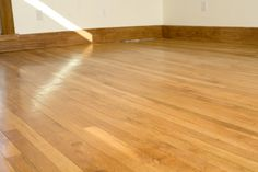 A waxy buildup on your hardwood floor tends to mar the appearance of the floor. The wax traps dust and dirt, dulling the colors of the wood and making the surface appear old and...