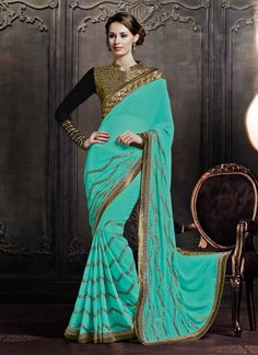 Featuring fabulous turquoise green crepe jacquard saree enhanced with embroidery,gota work and lace.It is paired with matching designer blouse which can be stitched upto size 42. For stitching enquiries, please email us at customercare@hunardesigns.com   …