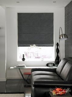 This faux suede #romanblind is in a dark grey colouring making it an ideal partner for modern metal furniture and steel kitchen appliances. From £75. Online at http://www.polesandblinds.com/artisan-jet-roman-blind/ #livingroom #interiordesign