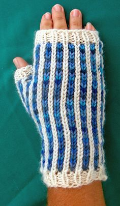 Create vertical lines without stranding or slipping any stitches. You choose whether you want the full coverage of a mitten, or to let your fingers be free.