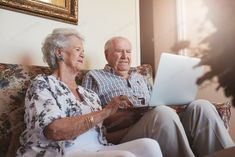 Senior couple sitting on a couch with a laptop by jacoblund. Indoor shot of senior couple sitting on a couch with a laptop computer. Old man and woman relaxing on a sofa using la. Elderly Couples, Young Couples, Technology Photos, Digital Technology, Real Estate Flyer Template, Home Photo, Pattern Drawing, Cute Woman, Design Bundles