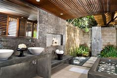 Balinese bathroom. open to the outdoors, and the garden in a wet area.m