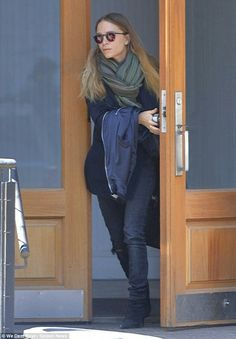 Out and about: Mary-Kate Olsen stepped out in New York on Thursday amid reports that the television show that jumpstarted her entertainment career, Full House, is nearing a deal for a revival on Netflix