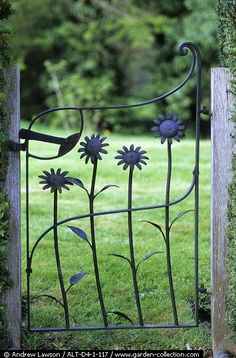 Wrought iron gate with sunflower shapes painted blue