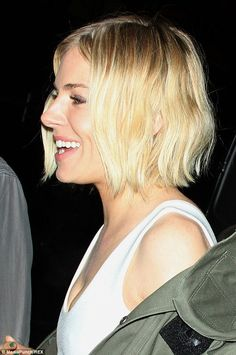 Blonde ambition: The actress's hair was bobbed and easily maintained with a centre parting...