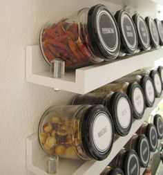 I like this simple shelving DIY for spices..use tin or wooden lids for a more shabby feel.