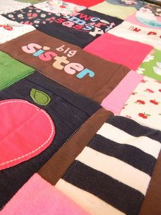 baby clothes quilt... love the idea, but i also love giving away things we are done with.  hhmmmm.