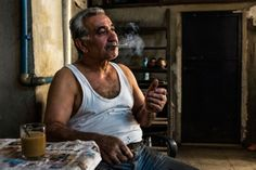 Man smoking in his workshop, Istanbul, Turkey