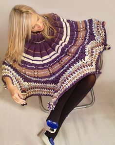 Keep yourself warm and stylish with this purple poncho/skirt. Colors: Royal purple, white, tan and some bluish details  Length: 24.8 inches (63 cm)