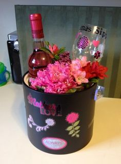 """Mother's day DYI gift: Buy a ice cube bucket, add stickers to bucket and plastic wine glass. Pick fresh flowers and a bottle of wine. Voila! Cheap and so cute. The wine glass says """"Oma's (grandma in German) Sippy Cup"""""""