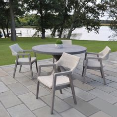 Kingsley-Bate: Elegant Outdoor Furniture. Provence galvanized steel round dining table with Spencer dining chairs.