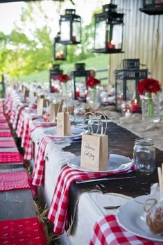 30 Rustic Barbecue BBQ Wedding Ideas ❤ rustic barbecue bbq wedding table decorated with lanterns with red candles flowers and napkins in white plates small paper bags martini wedding & event photography ❤ See more: http://www.weddingforward.com/rustic-barbecue-bbq-wedding/ #wedding #bride #weddingdecor #rusticwedding #rusticbarbecueBBQwedding