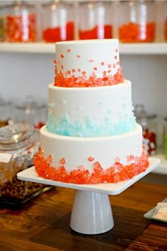 By using coloured rock candy on a wedding cake you can create a crystal elegant look while incoporating the colours of your wedding.